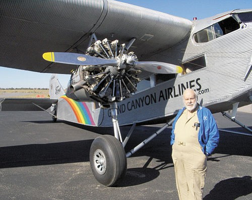 "Photo/Jack Hadley Wayne ""Chris"" Christensen stands with the Ford Tri-Motor he flew in recently, thanks to the crew at Grand Canyon Valle Airport."
