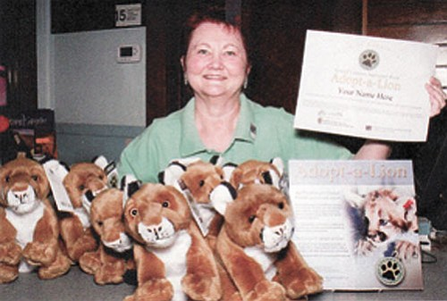 Photo/GCA GCA employee Virginia Martin tells park visitors about the Adopt-a-Lion Program.