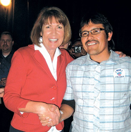 Arizona District 1 Congresswoman-elect Ann Kirkpatrick gets congratulated by Tony Skrelunas from the Grand Canyon Trust.