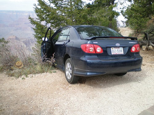 Authorities believed the brothers tried to drive over the Rim but got their car stuck instead.