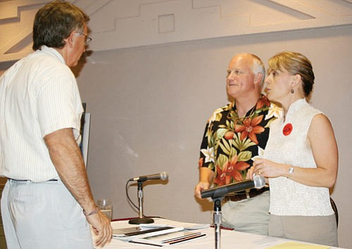 Clarinda Vail and Greg Bryan trade words with Justice Bill Sutton of Williams, who moderated a debate between both sides of the incorporation question.