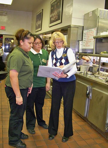 Rose Cameron shows hospitality students a list of instructions followed by bussers at El Tovar. The hour long job shadow was one of more than a dozen set up by Xanterra from mid-February to mid-March.