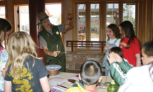 Youngsters learn to make split-twig figures at last year's Archaeology Day.