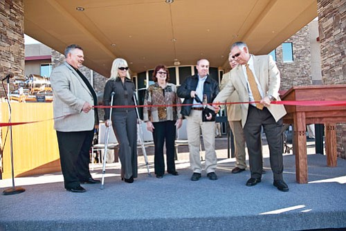 Officials and members of the Halvorson family cut the ribbon at the opening of their new Boulder City terminal.