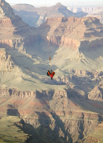 Photo/National Park Service A rescuer hangs from a helicopter above Grand Canyon. Approximately 20 people were involved in yesterday's rescue.