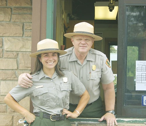 <br>Patrick Whitehurst/WGCN<br> Pictured are Visitor Use Assistants' Britney Mitchell and Dennis Reason at the entrance to Grand Canyon National Park. This weekend will mark the second of three free weekends at national parks across the United States.