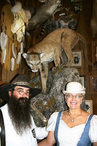 Patrick Whitehurst/WGCN Marshall and Bj Rader stand in front of the large mountain lion that strayed in front of their vehicle in November 2007.