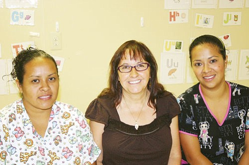 <br>Patrick Whitehurst/WGCN<br> Pictured from left to right is Kaibab Learning Center Co-Director Alejandra Flores, preschool teacher Judy Walker and preschool teacher Claudia Cordova. Not pictured is preschool teacher Dayle Browning.