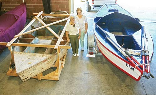 <br>Submitted photo<br> Marge Woodroof (left) is pictured with her daughter, Debbie. Woodroof's hand rests on a GEM boat built by her Uncle-in-law, Moulty Fulmer. Marge last saw that boat in 1957 when it looked more like the boat to her left.