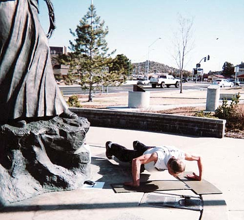 <br>Submitted photo<br> Fifty-seven-year-old Bill Kathan performs backhanded pushups in Prescott Feb. 14 as he tries for the record book.