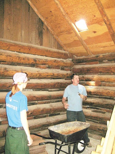 <br>Submitted photo<br> Assistant Forest Archaeologist Michael Lyndon works to restore Hull Cabin. The Forest Service expects to have the cabin available for rental by July.