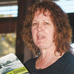 <br>Photo/Craig Andresen<br> Dana Wildsmith reads from her book 'Back to Abnormal' during the April 8 meeting of the Rotary on the Rim Club. Wildsmith is the April Artist in Residence at the Grand Canyon.