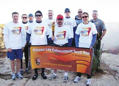 Submitted photo<br> Participants in the 2010 Torch Run stand at the South Rim of the Grand Canyon.