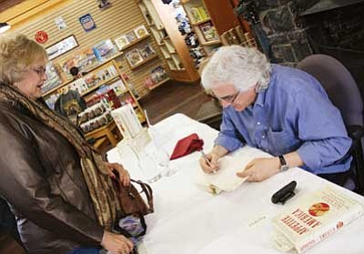 <br>Patrick Whitehurst/WGCN<br> Author Stephen Fried signs copies of his new book 'Appetite for America' while visiting Williams and the Grand Canyon for a recent book tour in northern Arizona.
