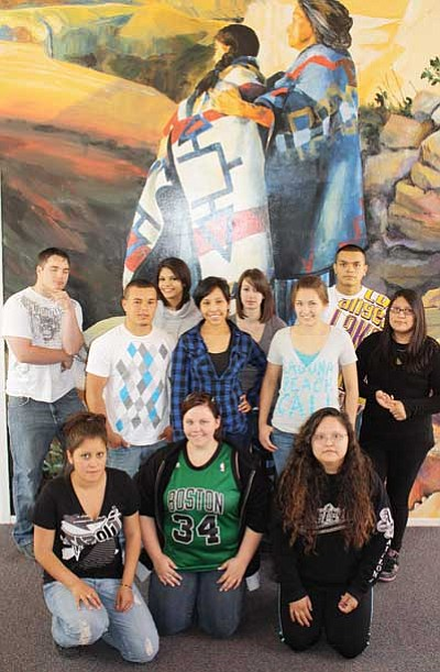 Patrick Whitehurst/WGCN<br> Pictured are students in Grand Canyon School's graduating senior class as they pose at the Shrine of Ages near the edge of the South Rim. Pictured is Miriam Bankston, Stephanie Begay, Daniel Celis, Keslee Foster, Veronica Garcia, Cuco Jaime, Tiffany Kerr, Tasha Ray, Monique Streit, Marissa Timeche and Erik Vessey.