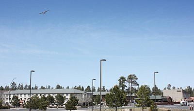 Patrick Whitehurst/WGCN<br> A plane flies over the community of Tusayan.
