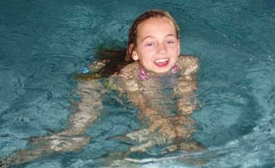 <br>Patrick Whitehurst/WGCN<br> A young swimmer enjoys the water at the Williams Aquatic Center.