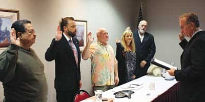Patrick Whitehurst/WGCN<br? Magistrate Bill Sutton, right, swears in new town council members and incumbent council members. Council members, pictured from left to right, are Al Montoya, Bob Blasi, Greg Bryan, Cecily Maniaci, and John Reuter.