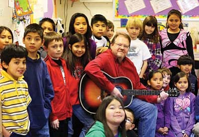 Ryan Williams/WGCN<br> Music and film teacher George Haughton rehearses with Kay Bordwell's third grade class in preparation for the Dec. 22 holiday concert at Grand Canyon School.