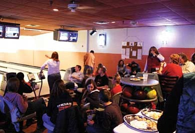 Clara Beard/WGCN<br> Mixer attendees bowl before Tim Martin discussed the Torch Run to be held in April.