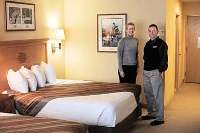 Ryan Williams/WGCN<br> Squire Inn Director of Sales and Marketing Freda Rahnenfuehrer and Rooms Director Billy Thompson display a newly renovated room at the Grand Canyon Squire Inn.