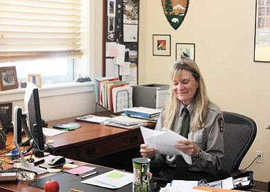 Clara Beard/WGCN<br> Lisa Eckert reviews some paperwork in her office at the Albright Training Center at Grand Canyon.