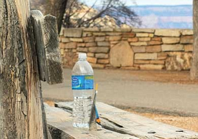 Ryan Williams/WGCN<br> Water bottles like the one left behind on a bench in front of Verkamp's Visitor Center account for 30 percent of the solid waste stream at Grand Canyon National Park.