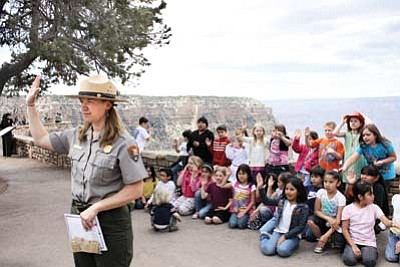 Clara Beard/WGCN<br> Grand Canyon School second grade teacher Jenn Marshall leads the swearing in ceremony April 20 at the South Rim of the Grand Canyon as her students become Junior Rangers.