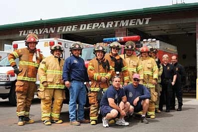 Ryan Williams/WGCN<br> Pictured top row left to right is Mike Cockrum, Tim Leija, Ben Gomez, Cody Bettencourt, Bob Petzoldt, Greg Brush, Pat Barker and Ray Kendall. Also pictured are Guardian Medical staff members Mark Kennedy and Dan Connela. Front row: Deputy Chief Bruce Baker and Chief Robert Evans. Not pictured is Lora Pitsinger, Robert Mazza, Jake Banks, Matt Anifnon, Heather Bettencourt and Dan Reger. The Tusayan Fire Department recently received a $180,000 SAFER grant. The funding will go toward firefighter salaries and training.