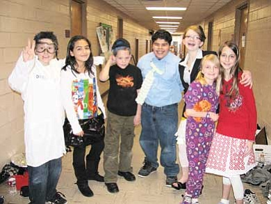 Submitted photo<br> The Grand Canyon School Odyssey of the Mind team don their costumes before running through their competition problem at a recent rehearsal. Pictured is Kyla Pearce, Jordan Long, Gunter Morris, Israel Herrera, Kylie Donehoo, Deya Ramos and an unidentified team member.
