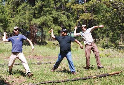 Photo/U.S. Forest Service, Southwestern Region, Kaibab National Forest<br> Atlatl throwing at the 2011 Dine College Native American Environmental Youth Camp.
