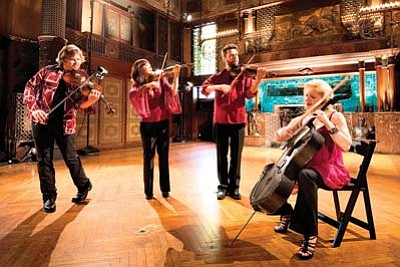 Photo/James Ewing<br> From left: Ralph Farris (viola), Jennifer Choi (violin), Cornelius Dufallo (violin) and Dorothy Lawson (cello) of ETHEL perform this weekend at Shrine of Ages.