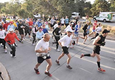 Photo/WGCN<br> Participants in last year's Grand Canyon Marathon run past the starting line inside Grand Canyon National Park.