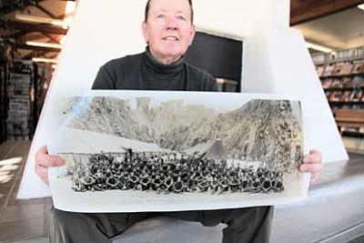 Ryan Williams/WGCN<br> Author Bob Audretsch displays an original photo of Civilian Conservation Corps Company No. 818 taken in Grand Canyon in 1935.