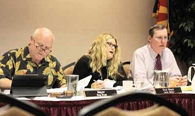 Clara Beard/WGCN<br> Tusayan Mayor Greg Bryan and Councilman Bill Fitzgerald listen as Vice Mayor Cecily Maniaci lists her reasons for approving zoning changes along with a development agreement between the town of Tusayan and Italian developers Stilo Group.