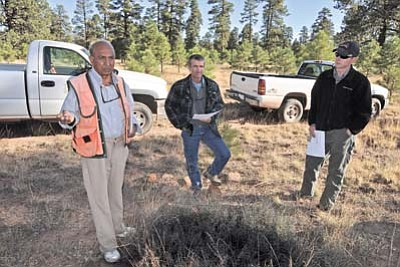 Photo: Kaibab National Forest, Southwestern Region, USDA Forest Service<br> Navajo Nation Forestry Department botanist A. K. Arbab speaks about a 2,200-acre reforestation project atop Defiance Plateau. On the right is Mark Nabel, Tusayan Ranger District forester, and in the middle is Garry Domis, North Kaibab Ranger District silviculturist.