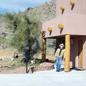 Fred Lucas stands outside his studio near Kingman. Lucas was well-known for his paintings of the Grand Canyon and Arizona's history and cowboys. He passed away earlier this month.