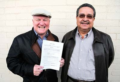 Ryan Williams/WGCN<br> Tusayan Mayor Greg Bryan and Councilman Al Montoya celebrate an escrow agreement between Stilo Group and the town of Tusayan.