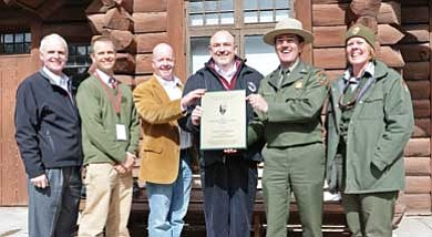 NPS photo/Michael Quinn<br> Grand Canyon Superintendent Dave Uberuaga and park EPA Specialist Deirdre Hanners present the Director's Environmental Achievement Award to (from left to right) Bob Baker, General Manager of Train Operations/Grand Canyon Railway (GCR); Jeff D'Arpa, GM of Resort Operations/GCR; Morgan O'Connor, Director of Sustainability/GCR; and Gordon Taylor, Vice President, Parks South, Xanterra Parks and Resorts.