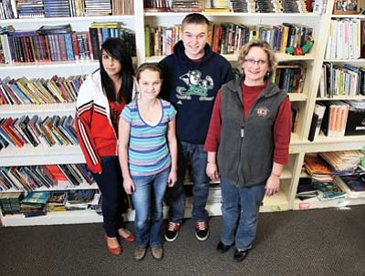 Ryan Williams/WGCN<br> From left: Grand Canyon School students Hailey Gaebel, Kylie Hartigan and Trevor Hartigan are all enthusiastically looking for ways to get their writing in print with help from their english teacher Lori Rommel.