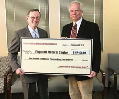Submitted photo<br> Timothy J. Gardner, MD, trustee, AstraZeneca HealthCare Foundation, presents Bert McKinnon, MD, Board of Directors Chair, Northern Arizona Healthcare, a check for $167,000 for the Northern Arizona Diabetes — Heart Connection program.