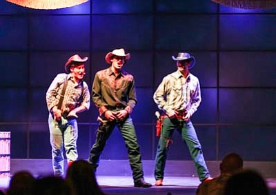 Joshua Taylor Hamilton (Shane Guthrie), Jeffrey Ricca (Captain Ogilvy) and Luis Alex Rodriguez (Cockeyed Frank Carson) perform in front of a large video screen used throughout the production. Ryan Williams/WGCN