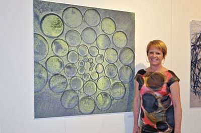 Deborah Bird stands next to a finished work. Submitted photo