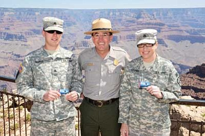 GC Park Superintendent Dave Uberuaga issued Grand Canyon's first two America the Beautiful Annual Passes for Military to Camp Navajo Sergeants Morse and Lozier. NPS Photo by Michael Quinn<br /><br /><!-- 1upcrlf2 -->