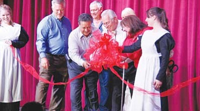 Tusayan Town Councilman Al Montoya and Grand Canyon Chamber of Commerce and Visitors Center Manager Josie Bustillos cut the ceremonial ribbon along with the theatre's owner, Elling Halvorson.