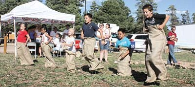 Children race for the finish line in a sack race. This year's Fourth festivities in Tusayan will feature plenty of fun for the whole family. Submitted photo