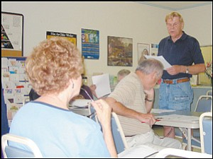 Bernie Christensen delivers the treasurer's report Wednesday during the monthly meeting of the Old Timer's Chat-N-Chow Site Council.