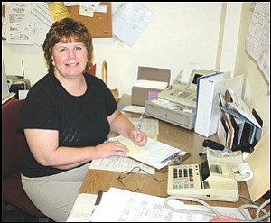 Director of Recreational Programs Debera Daugherty at her desk at the Kathryn Heidenreich Adult Center on Friday.