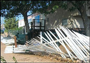 The fence in front of Rebecca Truair's house was damaged by the wind Wednesday.
