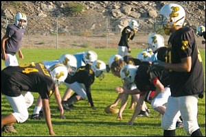 The Kingman Pop Warner Cobras line up for a play during practice at Southside Park last week.
